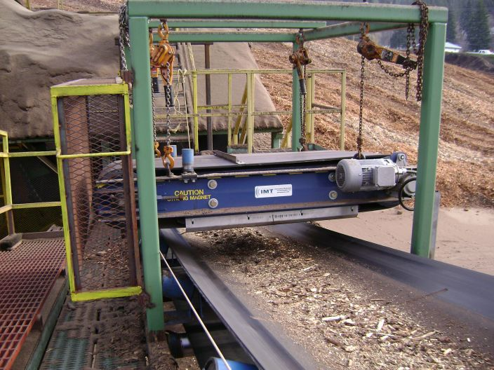 A cross belt separator in use at a mill over a conveyor belt